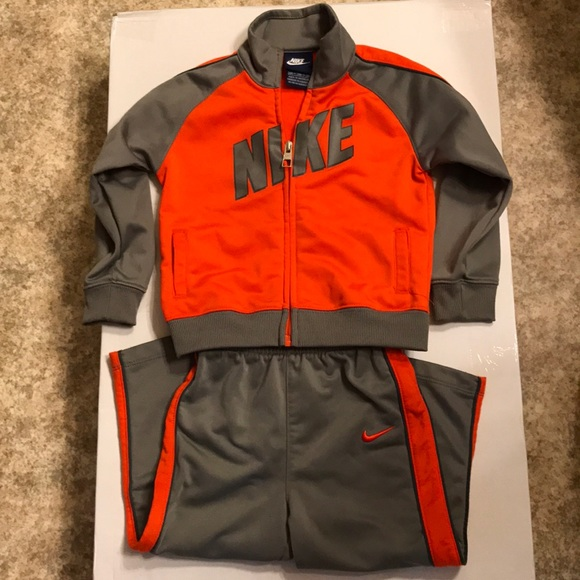 Orange and gray Nike jogging suit